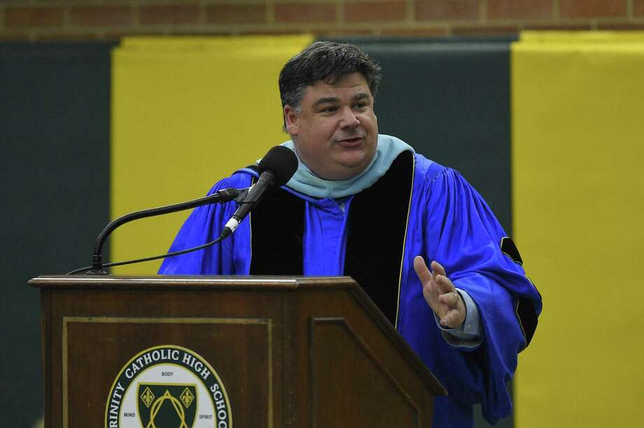 Dr. Steven Cheeseman, Superintendent of schools, Diocese of Bridgeport, addresses graduates and attendees during Trinity Catholic High School Class of 2019 commencement exercises on May 30, 2019 in Stamford, Connecticut. Photo: Matthew Brown / Hearst Connecticut Media / Stamford Advocate
