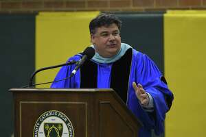 Dr. Steven Cheeseman, Superintendent of schools, Diocese of Bridgeport, addresses graduates and attendees during Trinity Catholic High School Class of 2019 commencement exercises on May 30, 2019 in Stamford, Connecticut.
