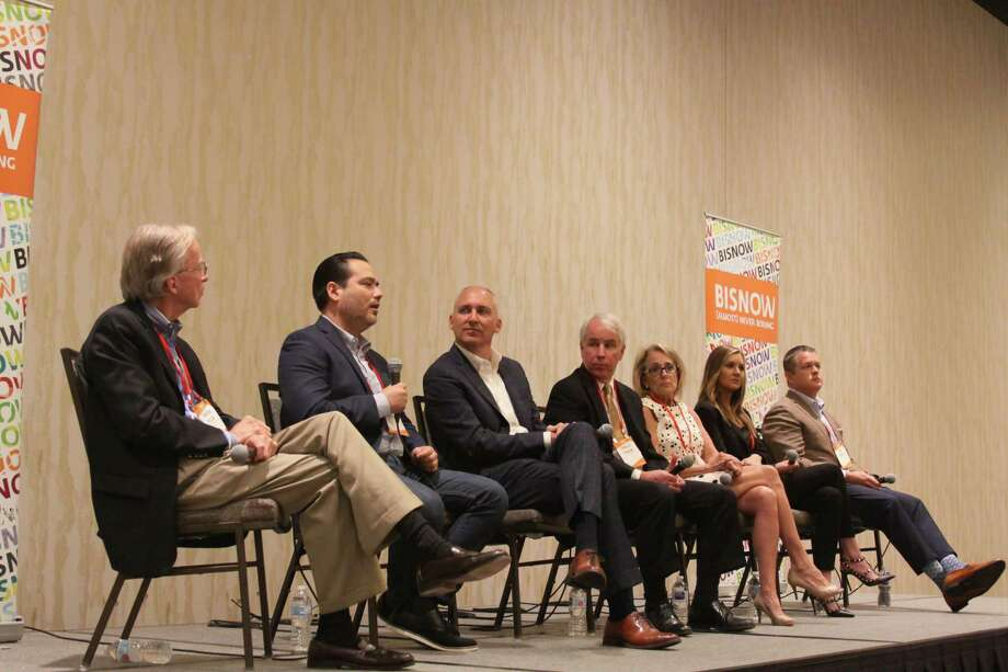Coventry Development Corporation executive vice president Warren Wilson moderates a panel on Springwoods Village at the Marriott Hotel which includes HP Inc. subregional delivery manager Benjamin Rodriguez, Patrinely Group CEO Robert Fields, Walter P Moore director of engineering Charlie Penland, JLL executive vice president Chrissy Wilson, Transwestern senior vice president Crystal Allen and Investments Regency Corp vice president Abe Pacetti. Photo: Mayra Cruz