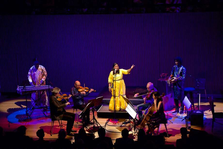 Hawa Kassé Mady Diabeté performs with the Kronos Quartet in 2018. Photo: Evan Neff / With Permission To The Chronicle 2018