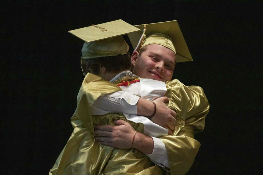 Conroe salutatorian Kyle Mrosko hugs valedictorian Preston Hart as Hart prepares to walk the stage during a graduation ceremony Wednesday, May 29, 2019 at The Cynthia Woods Mitchell Pavilion in The Woodlands. Photo: Cody Bahn, Houston Chronicle / Staff Photographer / © 2018 Houston Chronicle