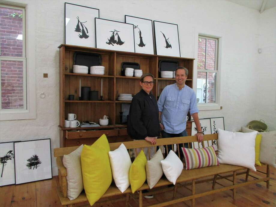 Milton Market partners Marsha Fish and Gerardo Figueroa get comfortable in their chic shop in Cobble Court. Photo: Jo Ann Jaacks / For Hearst Connecticut Media