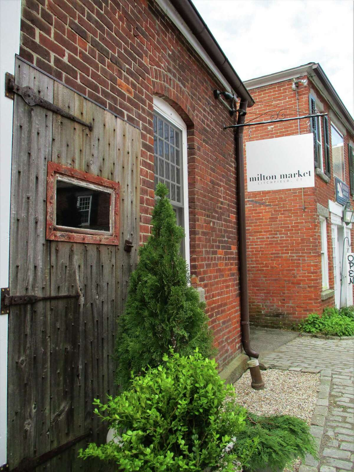 The exterior of Milton Market keeps the rustic character of the building, which was once used by a blacksmith when horse-and-carriage was the local transport.