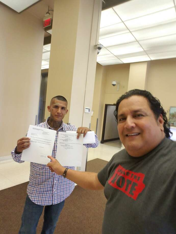 Christopher Torres holds up the important documents he got with the help of Ramon Chapa Jr. on Tuesday, May 28. Photo: Submitted By Ramon Chapa Jr.