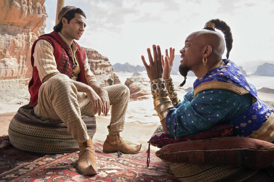 "This image released by Disney shows Mena Massoud as Aladdin, left, and Will Smith as Genie in Disney's live-action adaptation of the 1992 animated classic ""Aladdin."" Photo: Daniel Smith / Associated Press / Disney"