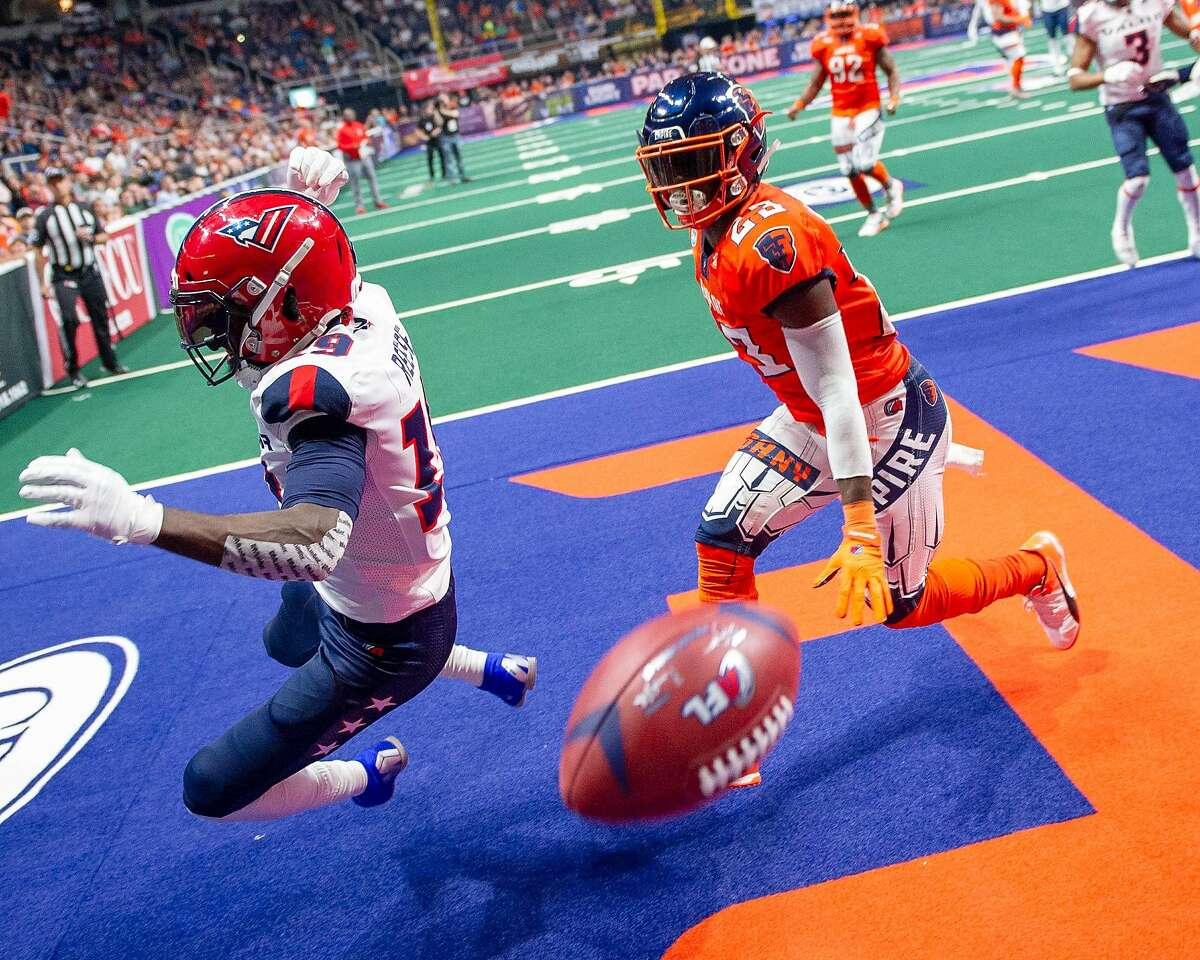 A pass thrown by Washington Valor quarterback Arvell Nelson sails past his wide receiver, Josh Reese, and Albany Empire defensive back Brad Muhammad during an arena football game at the Times Union Center on Saturday, May 4. (Jim Franco/Special to the Times Union)