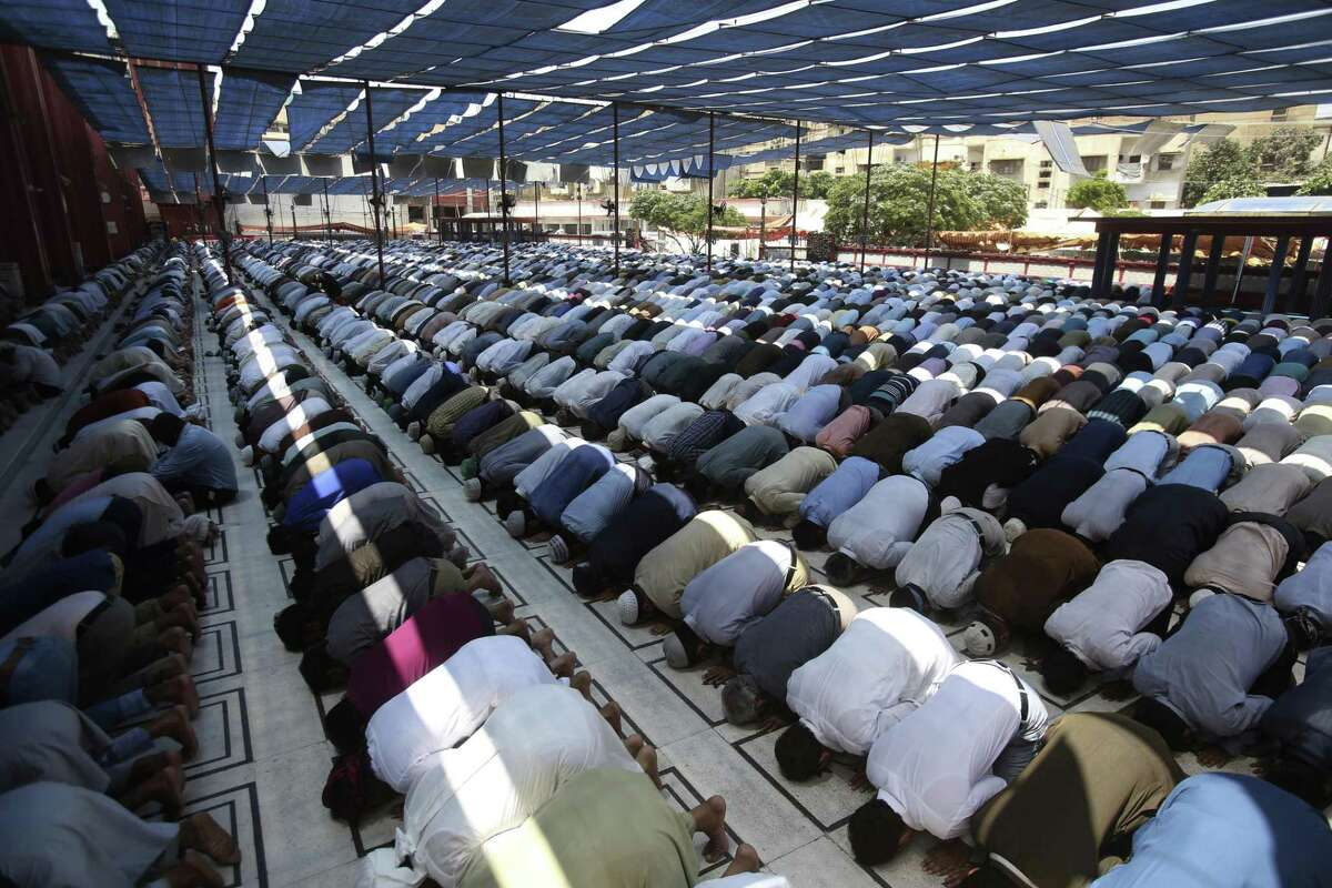 Worshippers offer prayers on Jumat-ul-wida, the last Friday of the Islamic holy month of Ramadan in Karachi, Pakistan, Friday, May 31, 2019. Muslims across the world refrain from eating, drinking and smoking from dawn to dusk during Ramadan.