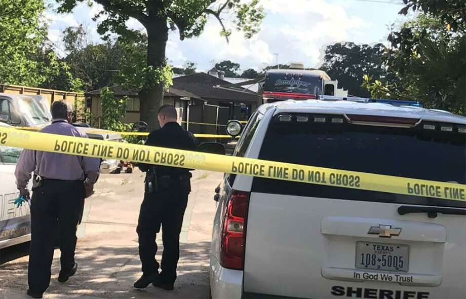 Deputies cordon off the area in the 10700 block of Stidham Road in Conroe, Texas. A 10-year-old boy was shot and killed, and a juvenile is being questioned in his death. Photo: Meagan Ellsworth/Staff / Houston Chronicle