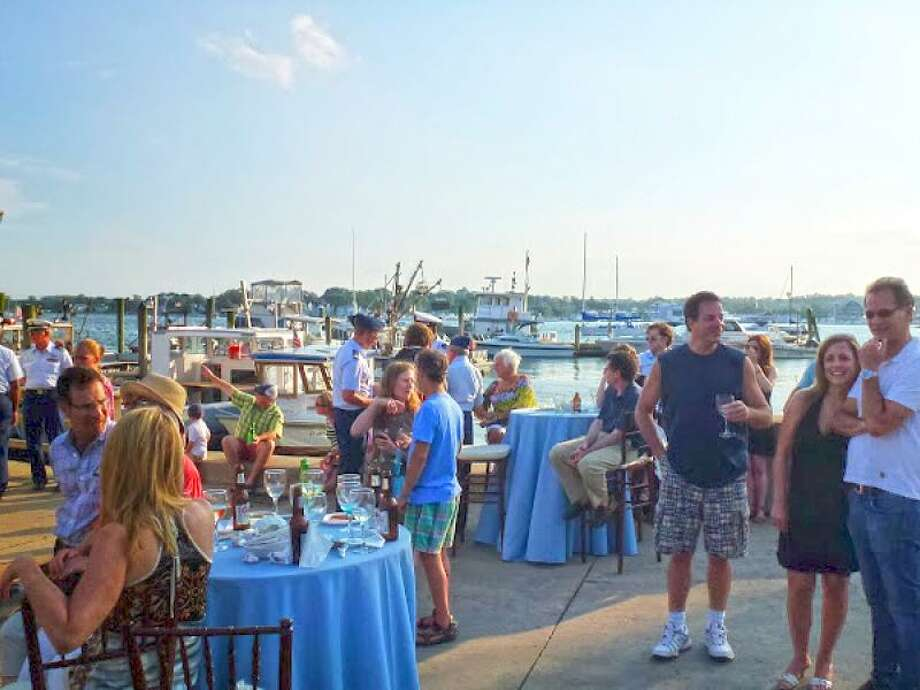 The Norwalk Seaport Association is hosting its popular Docktails and Oysters event at Norm Bloom and Son, a fourth-generation oyster farm in Norwalk, June 29. Photo: Norwalk Seaport Association / Contributed Photo