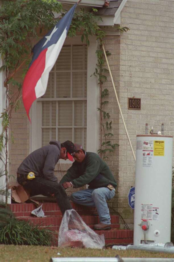 CONTACT FILED:  WATER HEATERS Brian Lewis, master plumber with Strutton Plumbing Co., Inc. replaces the hot water heater at 1903 Albans St. At Kent St. in the Rice University area under the state of Texas flag and cold overcast skies.  Helper is Proceso Cantoriano. 01/18/2001 (E. Joe Deering/Chronicle) Photo: E. Joseph Deering, Staff / Houston Chronicle / Houston Chronicle