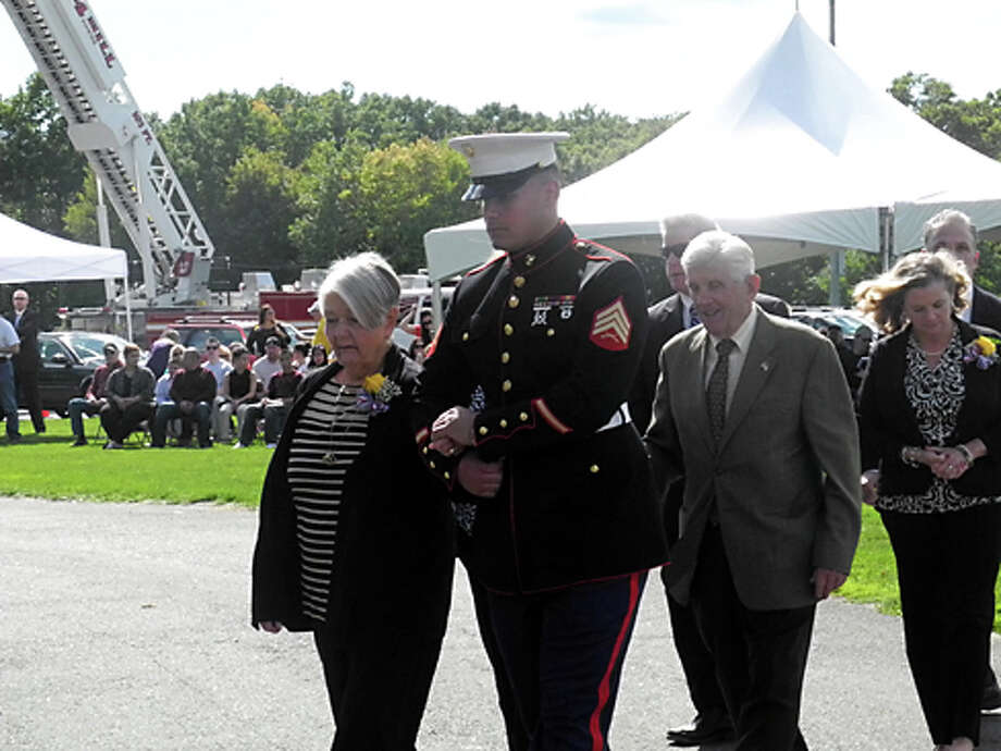 The family of Lt.j.g. Michael DeBartolomeo of Stamford are escorted to the state Saturday at Indian Ledge Park. DeBartolomeo was killed at age 25, while serving in the U.S. Navy in Operation Ocean Venture.