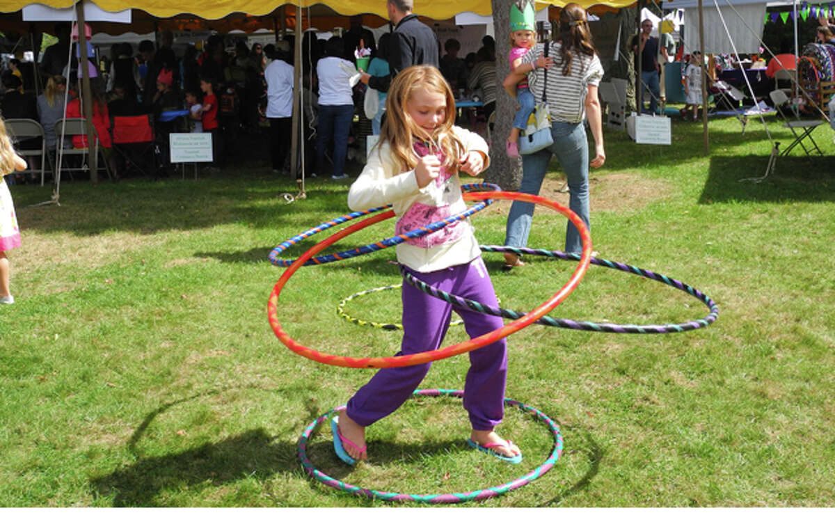 Kids played on the green with custom-made hula-hoops by bringthehoopla LLC.