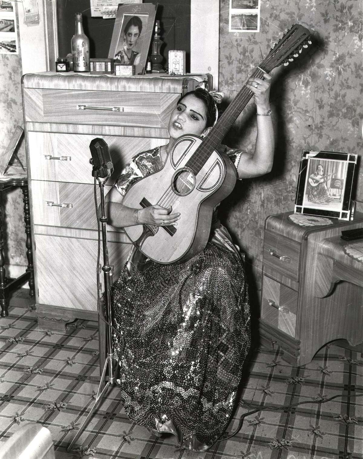 """Undated photo of Lydia Mendoza, who learned at a young age to sing and play the 12-string guitar. She later became known as """"The Lark of the Border."""""""