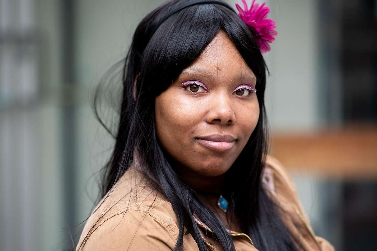 Michelle, who suffers from schizophrenia and bipolar disorder, sits for a portrait while waiting for a mental health hearing at Zuckerberg San Francisco General hospital on Thursday, May 30, 2019, in San Francisco. Placed in involuntary mental health treatment, she has spent months in a locked psychiatric ward at the hospital.