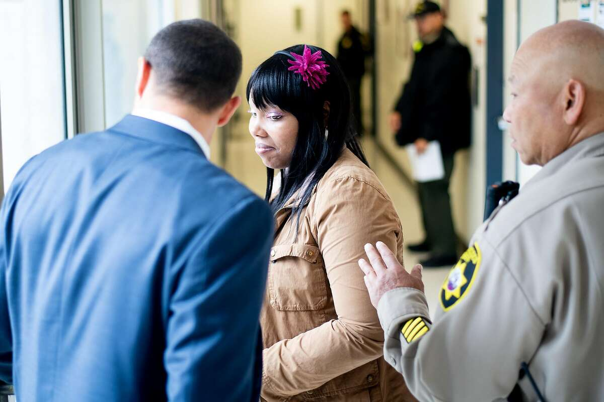 A sheriff's deputy escorts Michelle, who suffers from schizophrenia and bipolar disorder, from a mental health hearing at Zuckerberg San Francisco General hospital on Thursday, May 30, 2019, in San Francisco. Placed in involuntary mental health treatment, she has spent months in a locked psychiatric ward at the hospital.