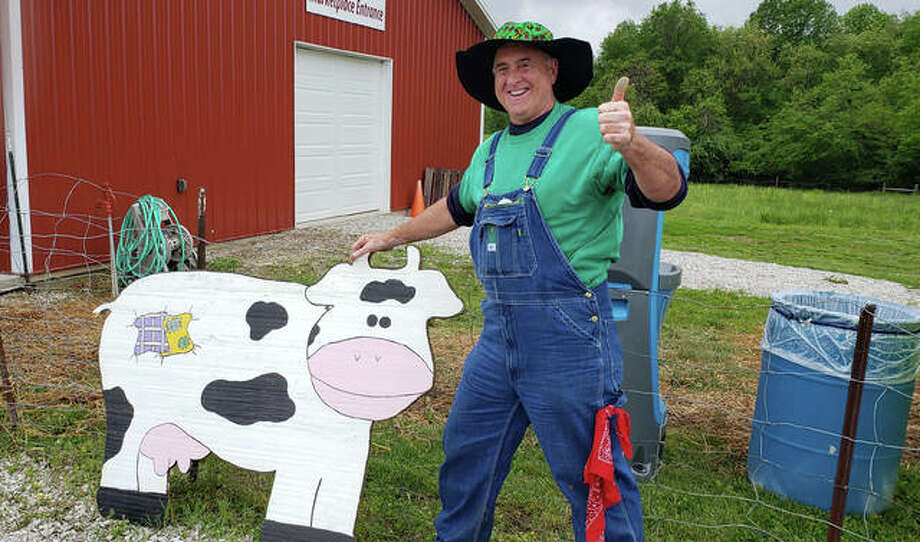 Joe Carrington, known by residents as Farmer Joe, smiles during his recent visit to Boonies Farm in Worden.