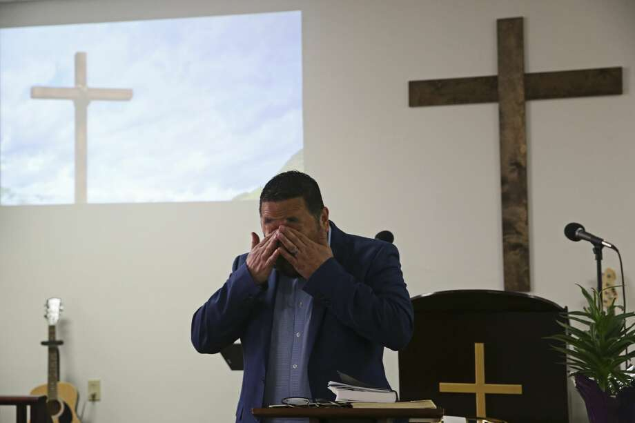 Pastor Erbey Valdez wipes tears while praying during Bible class at New Spirit Church in San Antonio. (Jerry Lara, Staff photographer | Express News)