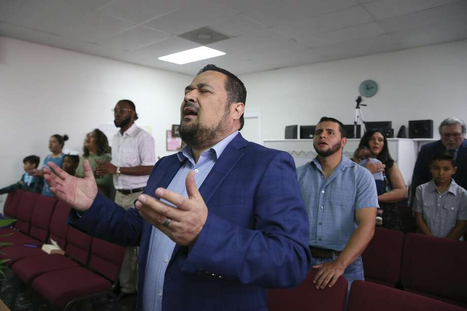 Pastor Erbey Valdez prays during a worship service at New Spirit Church in San Antonio. In 2010, Valdez pleaded guilty to felony charges of having sex with a 17-year-old girl when he was a middle school principal in Sonora, Texas. As a registered sex offender, he founded New Spirit in October of last year. The Southern Baptists of Texas Convention removed the church from its membership in April. (Jerry Lara, Staff photographer | Express News)