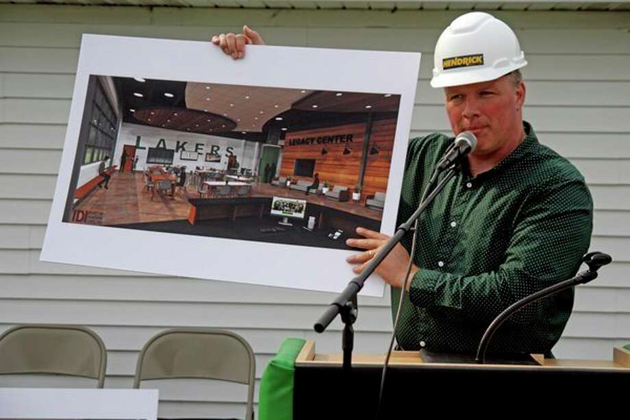 Laker Superintendent Brian Keim displays the renderings of the lobby of the Laker Innovation Center, which is set to be completed in July 2020. (Mike Gallagher/Huron Daily Tribune)