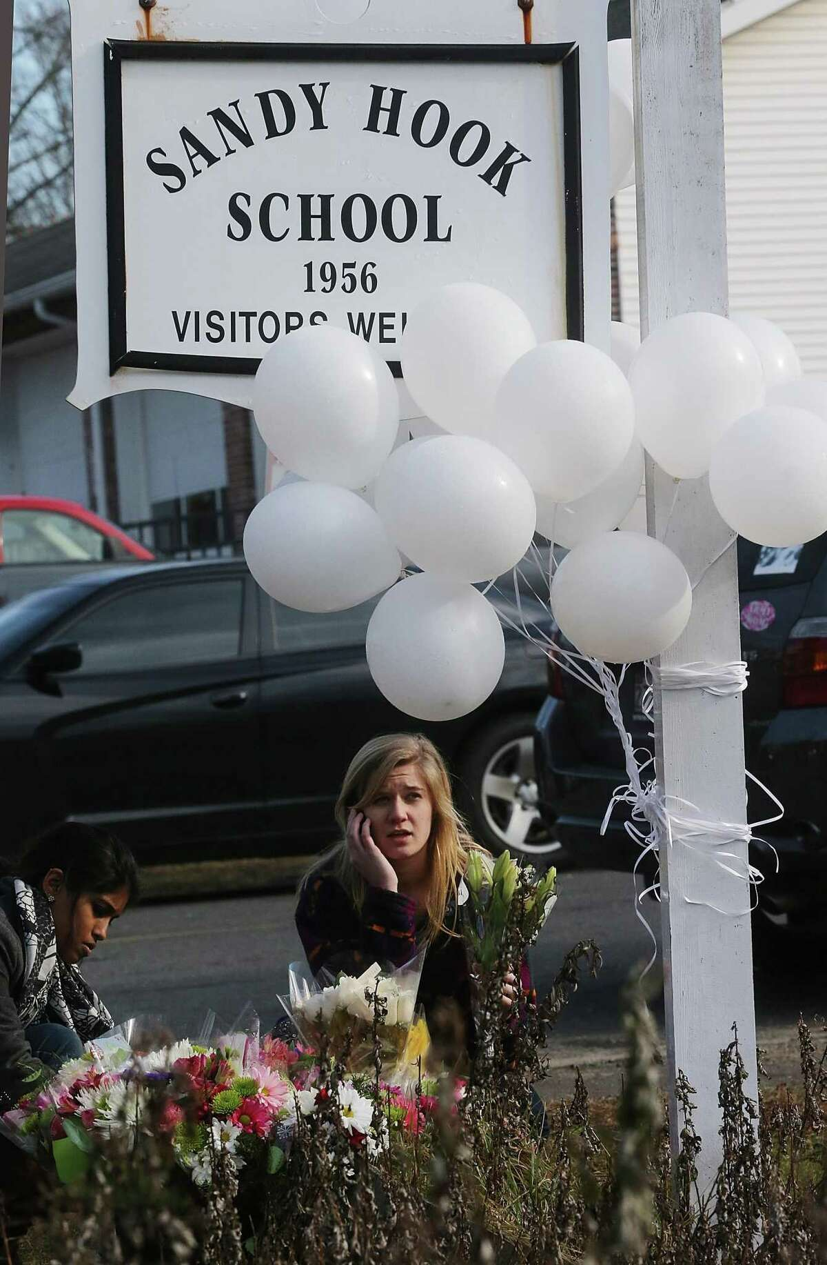 FILE - NOVEMBER 25, 2013: A report will be released today by Connecticut State Attorney Stephen Sedensky III summarizing the December 14, 2012 Newtown school shooting that left 20 children and six women dead inside Sandy Hook Elementary School November 25, 2013. NEWTOWN, CT - DECEMBER 15: People gather at a makeshift memorial outside a firehouse which was used as a staging area for families following the mass shooting at Sandy Hook Elementary School on December 15, 2012 in Newtown, Connecticut. Twenty six people were shot dead, including twenty children, after a gunman identified as Adam Lanza in news reports opened fire in the school. Lanza also reportedly had committed suicide at the scene. (Photo by Mario Tama/Getty Images)