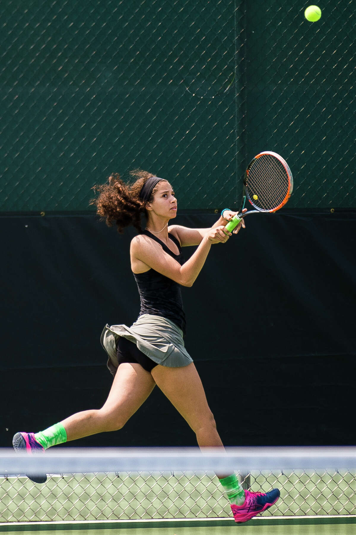 Dow's Salma Elsaadany returns the ball during a #4 doubles match in the Division 1 state tennis tournament on Friday, May 31, 2019 at the Greater Midland Tennis Center. (Katy Kildee/kkildee@mdn.net)