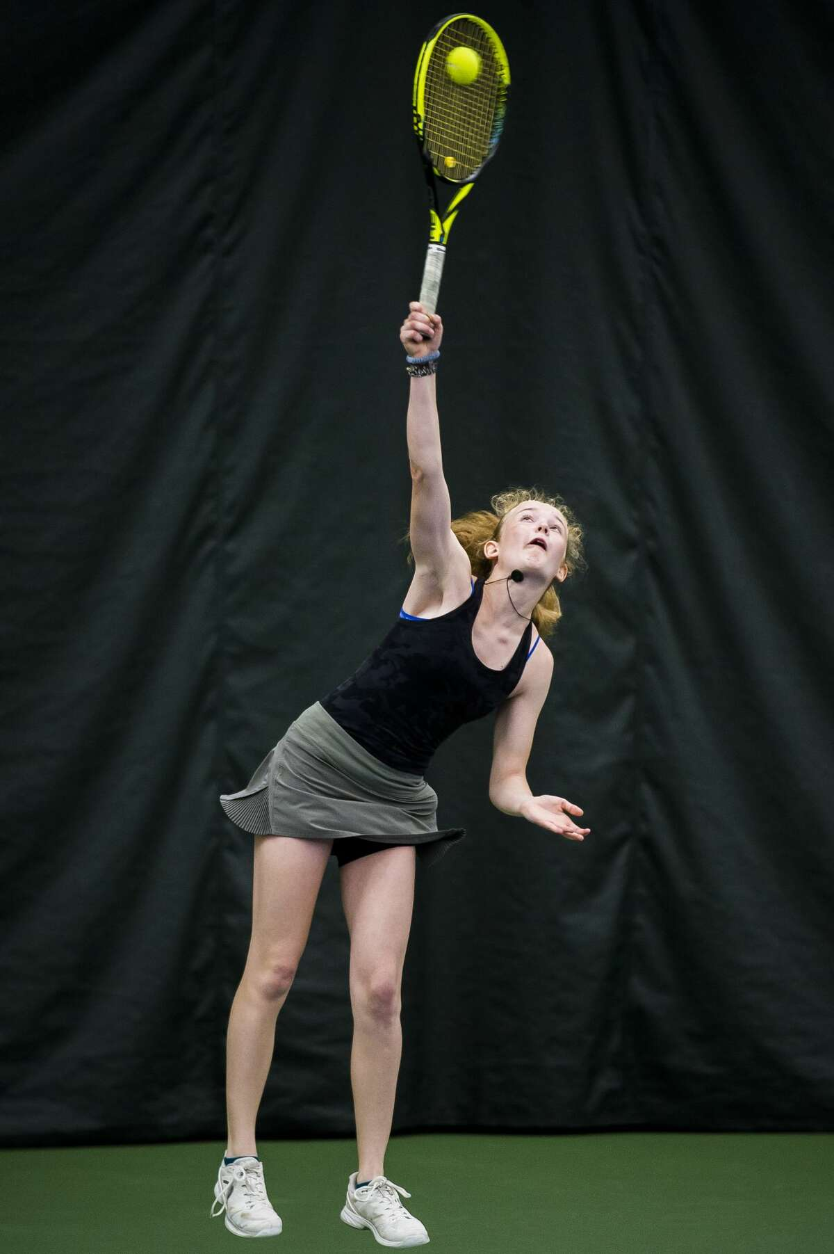 Dow's Laura Leiti serves the ball during a #3 singles match in the Division 1 state tennis tournament on Friday, May 31, 2019 at the Greater Midland Tennis Center. (Katy Kildee/kkildee@mdn.net)