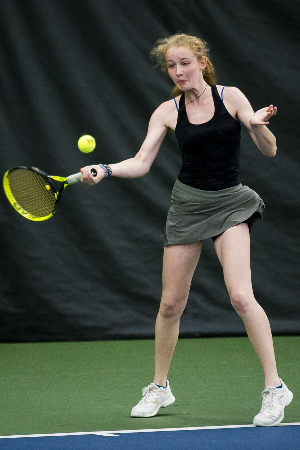 Dow's Laura Leiti returns the ball during a #3 singles match in the Division 1 state tennis tournament on Friday, May 31, 2019 at the Greater Midland Tennis Center. (Katy Kildee/kkildee@mdn.net)