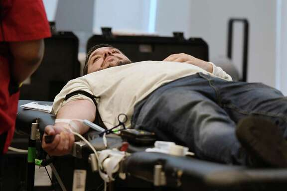 Matthew Peter gives blood during a blood drive in memory of Detective Jason Martin on Friday, April 26, 2019 at the Albany Capital Center in Albany, NY. Detective Jason Martin was a lifelong resident of Albany who worked for the city for 20 years and died last year of lung cancer. (Phoebe Sheehan/Times Union)