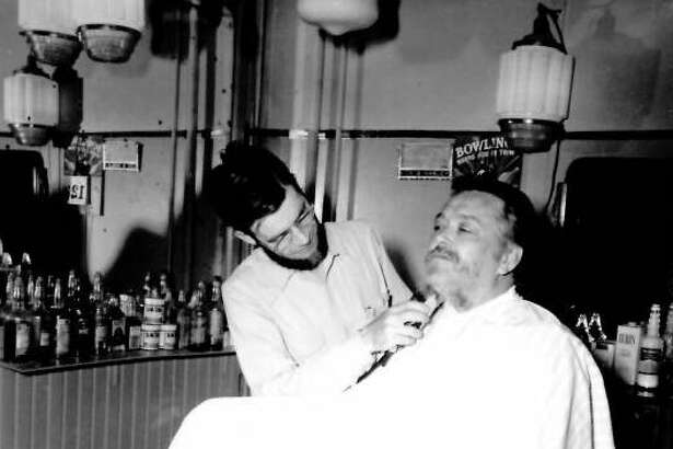 Chet Wright getting beard shaved off. Midland County Centennial Celebration June 9-11, 1950