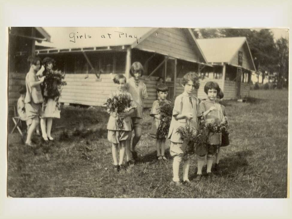 Children collecting flowers at The Homestead. (Saratoga County Historian)