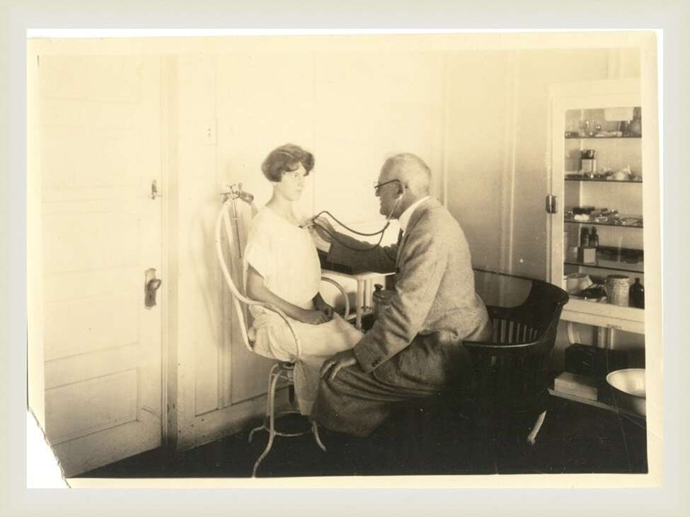 A doctor listens to the lungs of a patient at The Homestead. (Saratoga County Historian)
