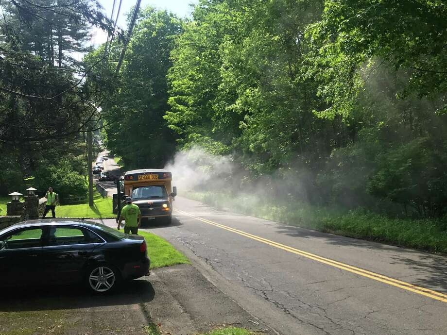 The Ridgefield Fire Department responded to a bus smoking heavily on George Washington Highway near the Old Mill Road intersection around 4 p.m. on Friday afternoon. No injuries were reported, and all children on the bus were evacuated, authorities said. Photo: Stephen Scheck / Contributed Photo