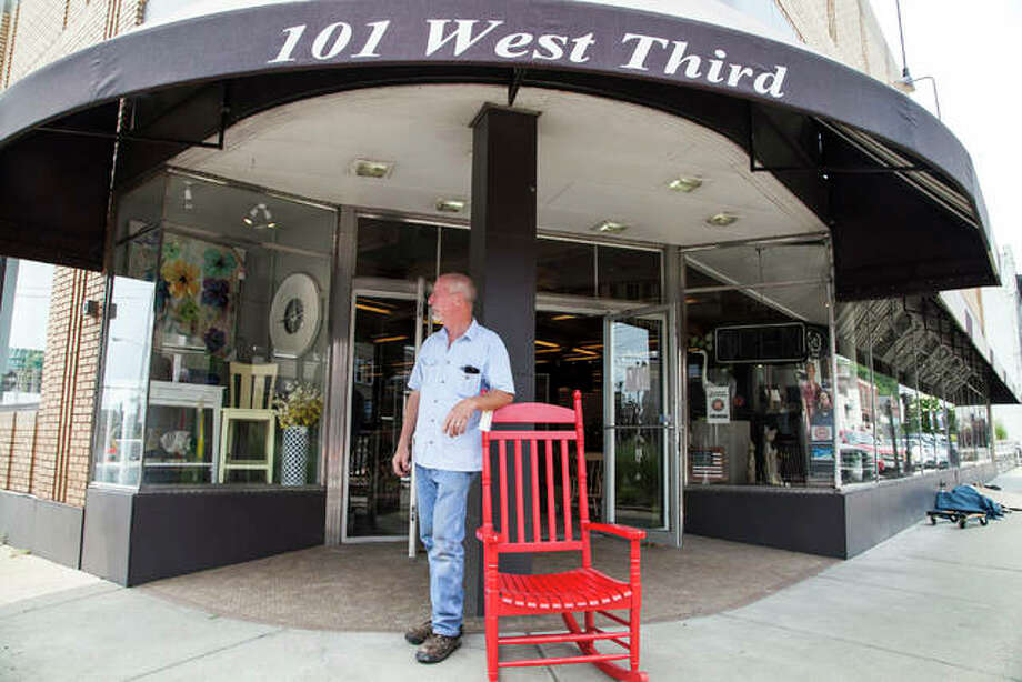 Ed Benz, owner of New Frontiers Home Furnishings, looks toward the rising water as he stands outside of his store on Third Street in Alton. The Mississippi River is expected to crest at 39.3 feet Tuesday Photo: Jeanie Stephens | The Telegraph