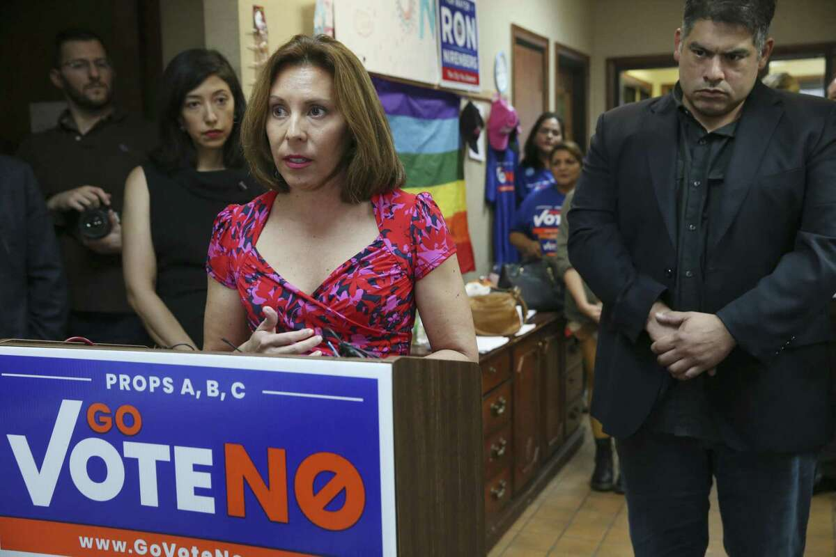 San Antonio City Council members Shirley Gonzales, middle, and Manny Pelaez, right - shown here at an Oct. 9 event - have teamed for a city initiative to combat domestic violence.