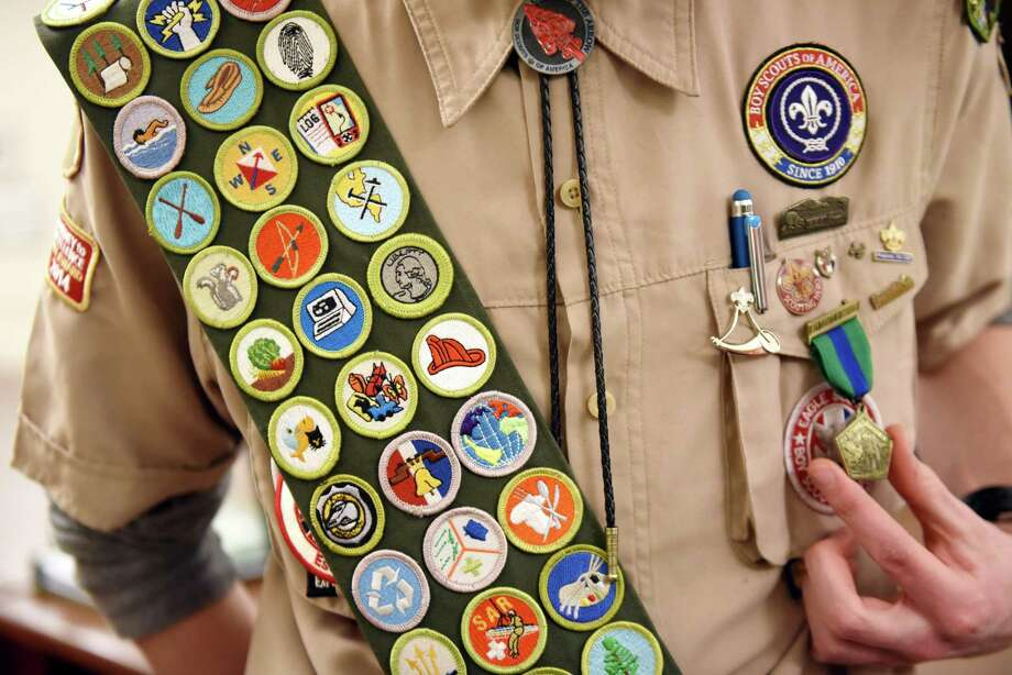 Eagle Scout Erick Christian of Delmar has earned all 138 Boy Scouts of America merit badges, March 6, in Delmar, N.Y. Considering the principles Boy Scouts must maintain, scouts should be considered for more leadership positions. Photo: Will Waldron /Albany Times Union / 40046338A