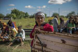 People of El Estribo village attend a community meeting, in Chaco, Paraguay, May 24. Paraguay's government and the United Nations are successfully chipping away at poverty in the village of El Estribo.