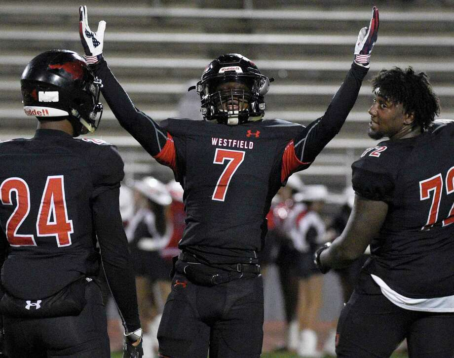 Westfield's Ashton Cakllaway (7) celebrates the team's win over Klein as Jaden Perkins (24) and Cedric Claiborne look on in a high school football game, Friday, Nov. 16, 2018, in Spring. Photo: Eric Christian Smith, Contributor / Contributor