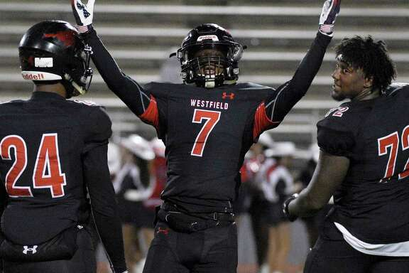 Westfield's Ashton Cakllaway (7) celebrates the team's win over Klein as Jaden Perkins (24) and Cedric Claiborne look on in a high school football game, Friday, Nov. 16, 2018, in Spring.