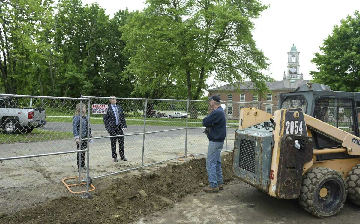 Newtown First Selectman Dan Rosenthal and Christal Preszler, Deputy Director of Planning Department Economic and Community Development, talk with David Kingsley, right, who is contractor and partner of a new brew pub being built in Stratford Hall on the Fairfield Hills Campus in Newtown, Conn. Thursday, May 30, 2019.