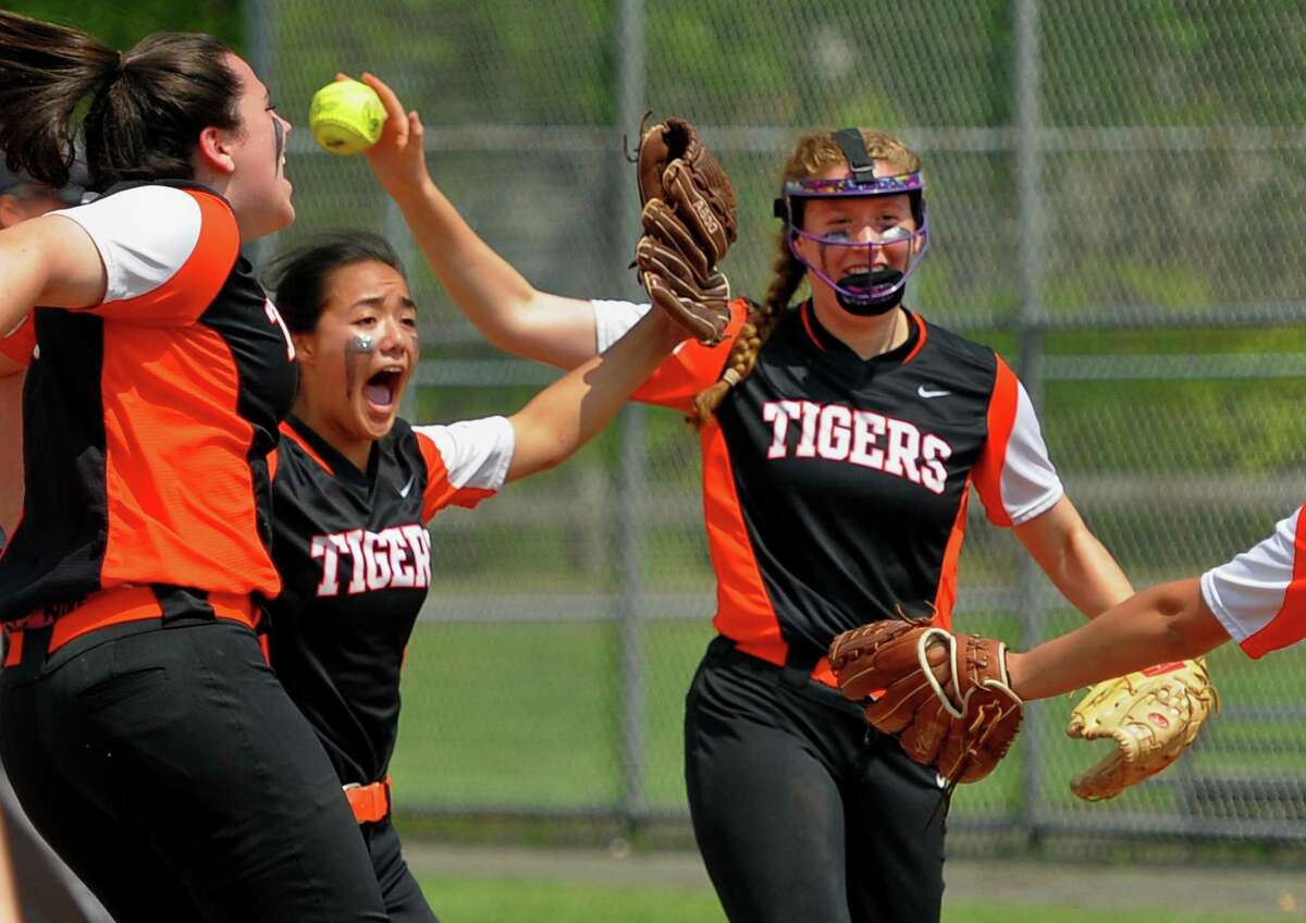 Ridgefield celebrate its win over West Haven during Class LL softball action in West Haven, Conn., on Friday May 31, 2019.