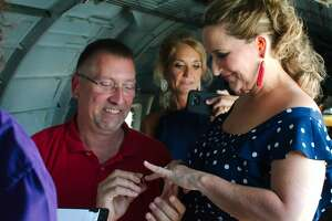 Katy couple Chuck McInturff and Stephanie Montez were married in a vintage B-17 bomber while flying over Ellington Airport.   The Lone Star Flight Museum event marked the 100th anniversary of the first couple to wed over Ellington in 1919.