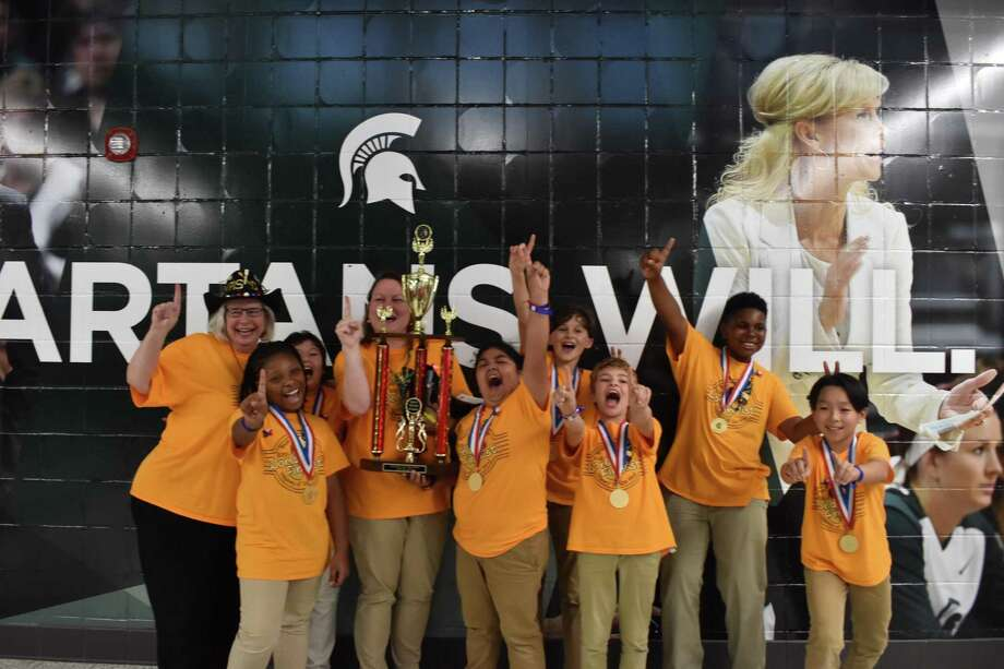 The Odyssey of the Mind team from Walnut Bend Elementary School celebrates their first place victory at the world finals May 22-25 at Michigan State University. Pictured from left: Principal Michele Dahlquist, Clarke, Daniella, Assistant Penny Blair, Melyna, Elliot, Brody, Jeremy and Hans. Photo: Courtesy Photo