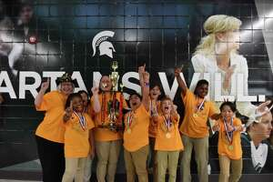 The Odyssey of the Mind team from Walnut Bend Elementary School celebrates their first place victory at the world finals May 22-25 at Michigan State University. Pictured from left: Principal Michele Dahlquist, Clarke, Daniella, Assistant Penny Blair, Melyna, Elliot, Brody, Jeremy and Hans.