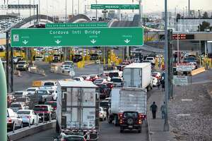 Cars and trucks line up at the checkpoint into Mexico at the Cordova International Bridge. The sheer volume of North American commerce makes is unlikely that most Republicans will block the USMCA, especially those from border states uch as Texas, where exports to Mexico reign supreme.