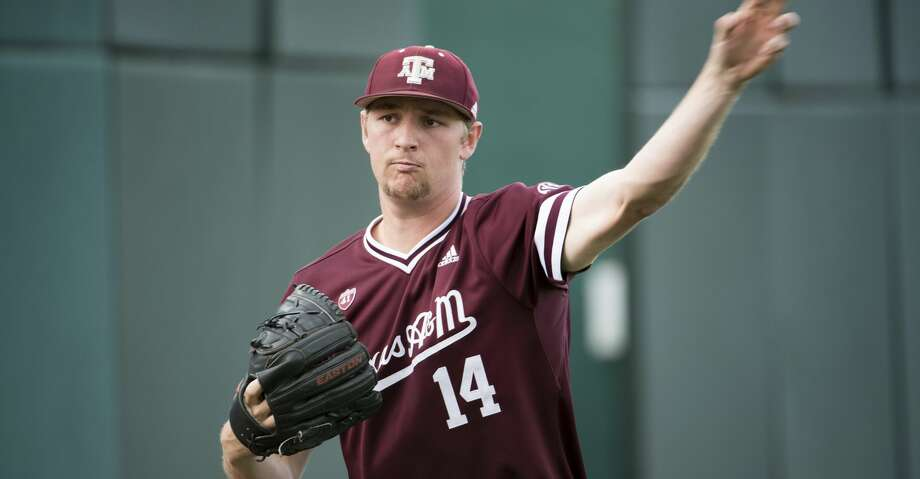 Texas A&M pitcher John Doxakis throws to a teammate before an NCAA college baseball game, Thursday, April 18, 2019, in Columbia, S.C. (AP Photo/Sean Rayford) Photo: Sean Rayford/Associated Press