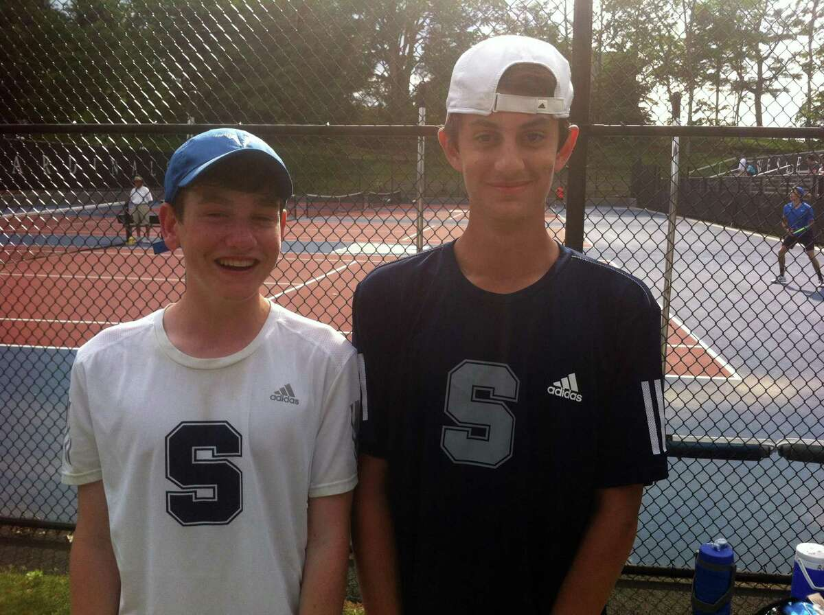Tighe Brunetti, left, and Robbie Daus of Staples won the Class LL double title on Friday at Wesleyan University.