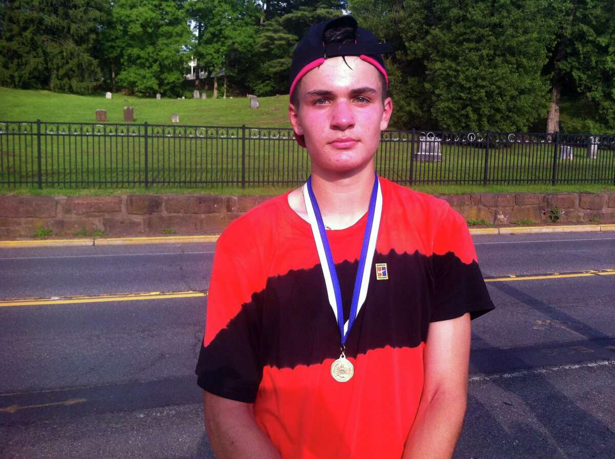 Trumbull's Andrew Ilie won the Class LL singles title on Friday.