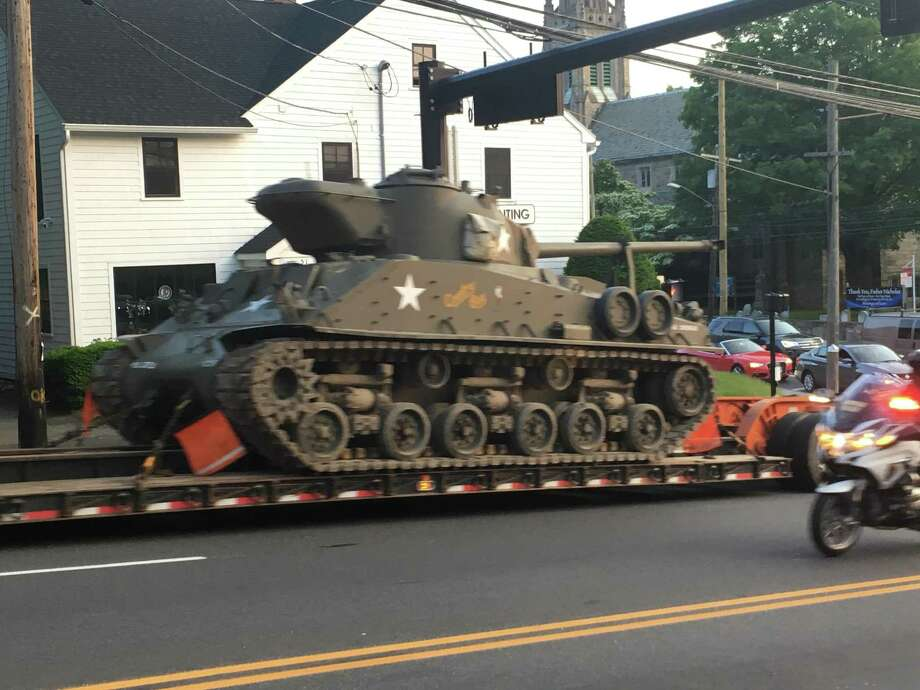A Sherman tank on its way to the American Legion Post 12 celebration on Westport Avenue Friday evening. Photo: Nathaniel Grauel / Hearst Connecticut Media