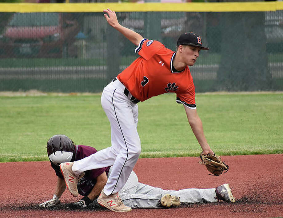 EHS second baseman Logan Cromer attempts to tag out a Belleville West base stealer on Wednesday in O'Fallon. Photo: Matt Kamp | For The Telegraph