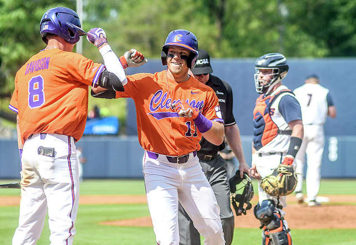 Clemson's Michael Green (11) is congratulated by teammate Logan Davidson (8) after hitting a home run against Illinois at the NCAA Oxford Regional Friday in Oxford, Miss.